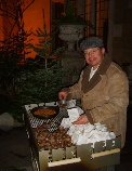 chestnut vendor using an open fire