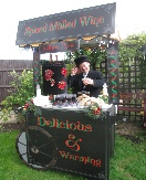 Victorian street cart serving mulled wine and mince pies