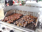 rosting chestnuts on  vendor cart