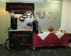 office reception set-up of mulled wine and mince pies